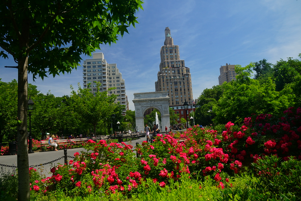 Entrance of Washington Park on a gorgeous summer day in New York City