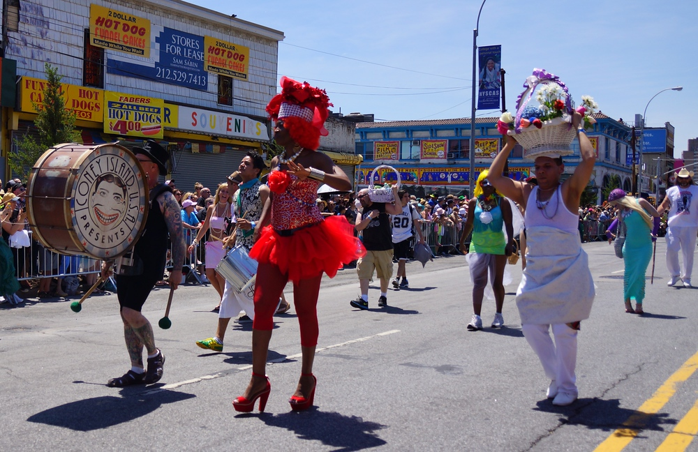 A group of paraders decked out in fancy marine costumes at the Mermaid Parade in Coney Island, New York City.