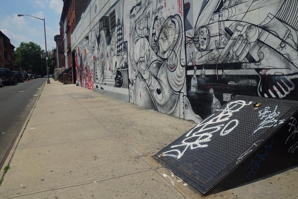 Street art and graffiti mural on a wall in Williamsburg Brooklyn New York City