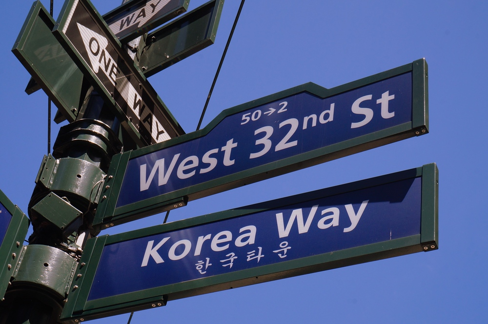Korea Way and West 32nd Street sign post in Little Korea New York City
