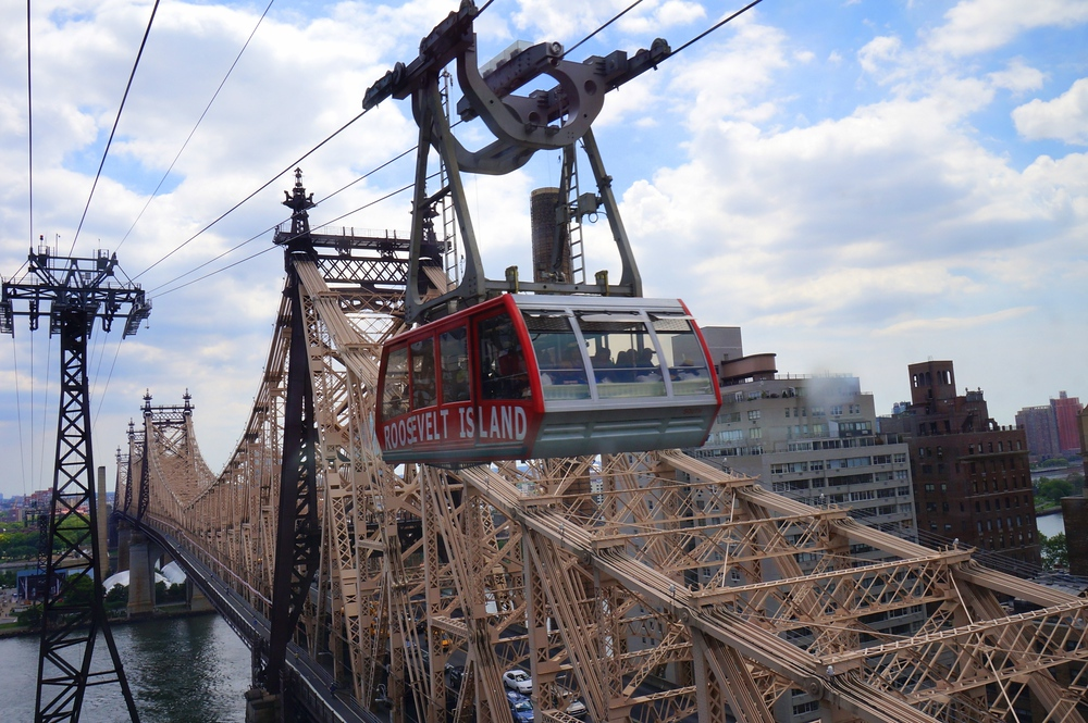 Aerial views of New York City on the Roosevelt Island Tramway crossing over a bridge