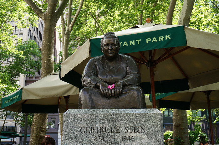 A statue of Gertrude Stein at Bryant Park behind the New York Public Library.