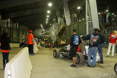 cars line up on the ramp to the track