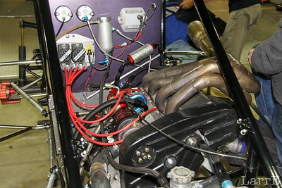 Some engines are laid in their side with the exhuast on the top