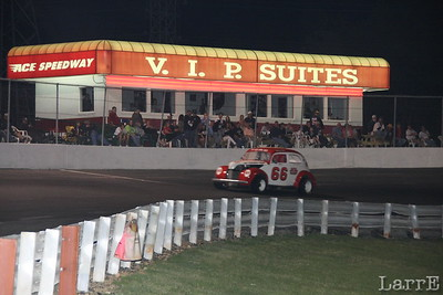 Vintage cars race past the turn four VIP stands