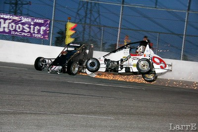 Ross hits Sam hard and drives him along the turn four wall...