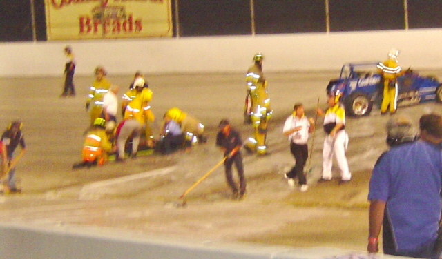 Driver Johnny Hydenrich still lays on the ground many minutes after his crash. Lots of flames, which he could not get away from. Thank goodness no serious burns but some lung problems and pretty sore.
