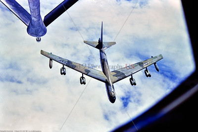 B-52D 005 A top view of a flying Boeing B-52D Stratofortress, USAF strategic long range bomber, in SE Asia Vietnam War color scheme, 8-1980, dropping away from a KC-135 aerial refueling tanker, by Stephen W  D  Wolf   EEE_9475   Dt