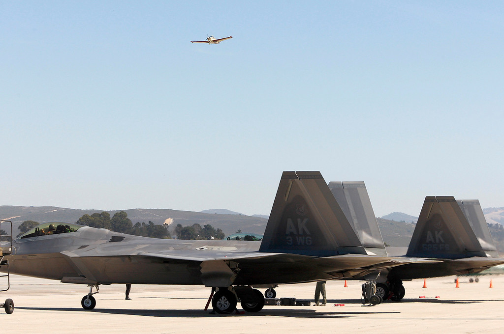 . A small plane takes off over two USAF F-22 Raptor jets at the Monterey Regional Airport on Tuesday, Sept. 26, 2017.  The two F-22 Raptors were in town to appear at the California Airshow Salinas this weekend.  (Vern Fisher - Monterey Herald)