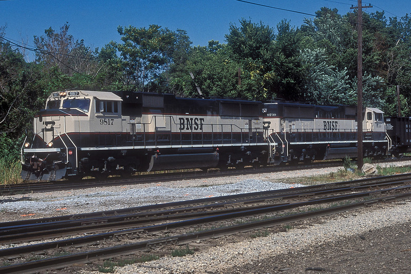 BNSF SD70MAC9817 and 9739 pass Dolton Junction with coal empties on 28 July 1998
