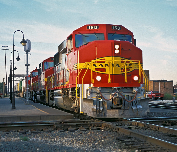 Santa Fe GP60M units 150, 140, 114 and 122 in sparkling Warbonnet livery lead a westbound through Joliet on 12 October 1994