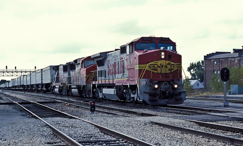 Santa Fe B40-8W 566 leads GP60M 105 and GP60B 345 through Joliet on 14 October 1994