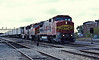 Santa Fe B40-8W 566 leads GP60M 105 and GP60B 345 through Joliet on 14 October 1994