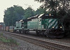 Burlington Northern SD40-2 8129 and B30-7A 4058 run through Rochelle with a stack train on 8 July 1998