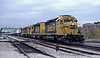 A pair of Santa Fe SD40-2 locos, 5081 and 5212, head SF30C 9530 and B40-8W 7445 through Joliet on 14 October 1994