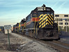 The morning service to Blue Island cruises through Joliet on 14 October 1994 behind IAIS GP38 600, GP10 431 and 403.