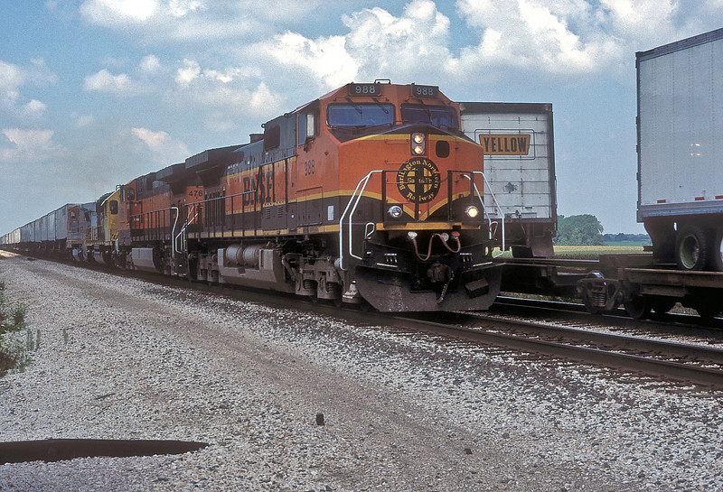 BNSF C44-9W 988 and 4766, Santa Fe SD40-2 5027 and B40-8W 523 pass a westbound intermodal at Streator on 27 July 1998