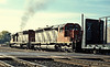 Canadian National SD40-2 5201 and 5119 head west out of the Burlington Northern yard at Eola on 12 October 1992