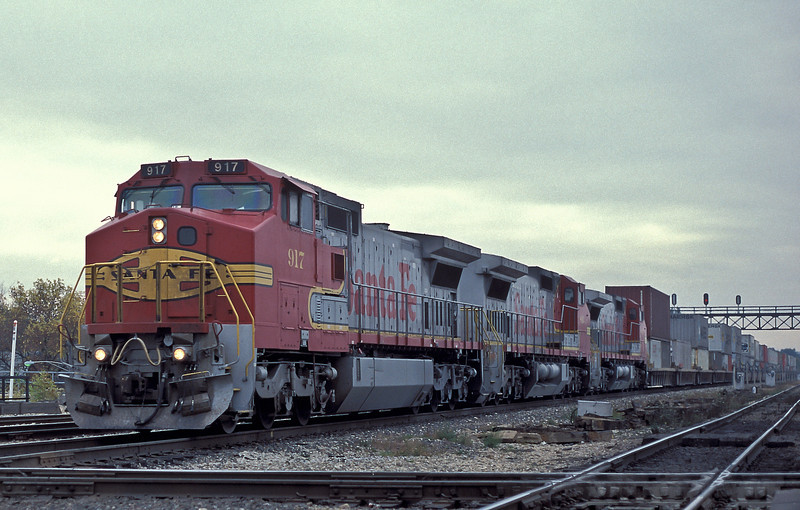 Santa Fe C44-8W 917, 816 and 801 head toward Chicago with a stack train at Joliet on 14 October 1994