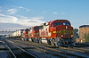 A fine October evening at Joliet as Santa Fe GP60M 115 and 133 with B40-8W 577 head toward Chicago on 13 October 1994
