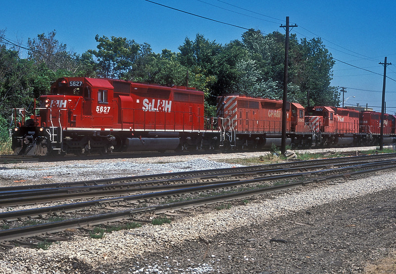 Four SD40-2 locos of Canadian Pacific pull through Dolton Junction on 28 July 1998 - 5627 is wearing the then new St. Lawrence and Hudson livery, 5643 and 5577 are in standard colours and 5616 brings up the rear in the 'flag' livery