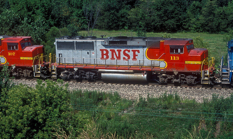 A portrait of former Santa Fe GP60M 113, now wearing the side marking for BNSF at Streator, Illinois on 27 July 1998