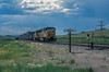 Passing over the lines between Laramie and Cheyenne in the area known as Sherman Hill are Union Pacific SD60M 6339, SD60 6047 and Southern Pacific GP60 9689 on 14 July 1998.