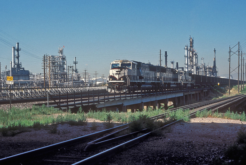 An empty coal train headed by BNSF SD70MAC 9456, 9542 and 9696 heads through Commerce City on 17 July 1998