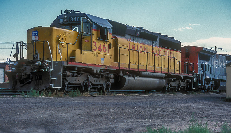 Waiting for its next job in the Union Pacific 38th Street yard in Denver on 15 July 1998 was SD40-2 3461.