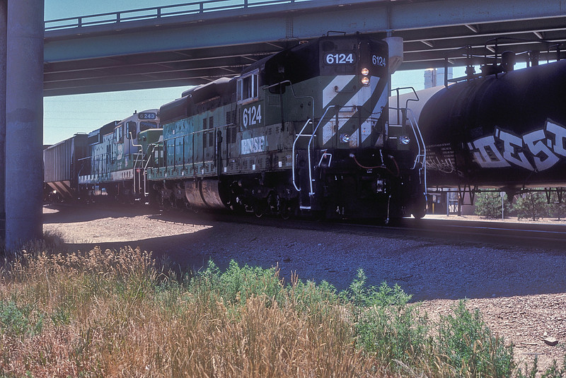 Burlington Northern SD9 6124 and chop-nosed 6243 (later re-numbered to 6140) were working the local industries at Commerce City on 18 July 1998