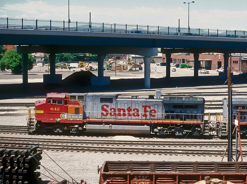 Santa Fe C44-9W 642 has gained an air conditioning unit from a 'Pumpkin' unit as it sits in the yard of the locomotive facility at Denver on 18 July 1998