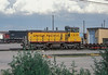 Former Southern Pacific SW1500 now wears a coat of yellow as Union Pacific 1215 at Denver North Yard on 15 July 1998.