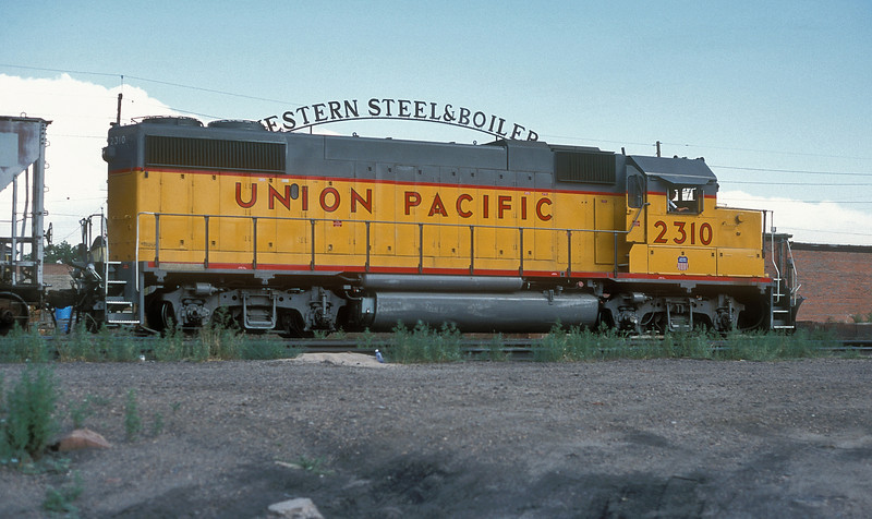 Union Pacific GP38-2 2310 (a former Missouri Pacific engine) works a short freight past the yard at 38th Street in Denver on 15 July 1998