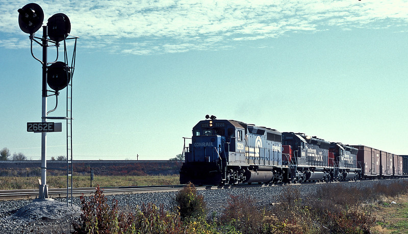 Conrail GP40-2 3226 heads newly re-manufactured Southern Pacific SD40-2 8668 and 8667 through Oak Harbor on 16 October 1994