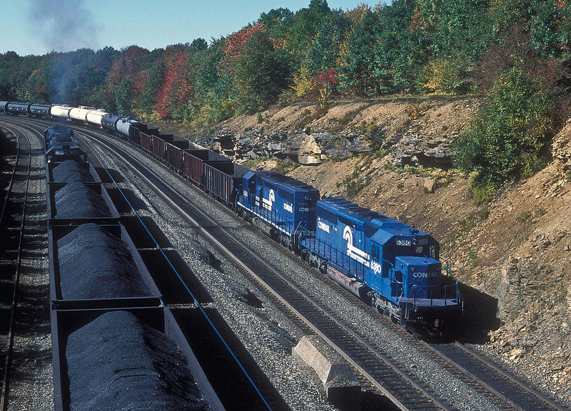 The view from the State Road 53 overbridge looking towards Cresson on 2 October 1994 has Conrail helper set of SD40-2 6380 and 6384 at the rear of a westbound as another pair get to grips with an eastbound coal train