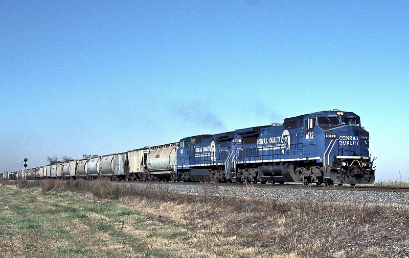 A pair of Conrail C40-8W locos, 6172 and 6101, head eastbound through Oak Harbour on 16 October 1994
