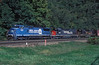 A strange sight on Horseshoe Curve! Conrail C40-8W 6124 leads Southern Pacific SD40T-2 8573 and Denver & Rio Grande GP40-2 3090 with a westbound freight on 30 September 1994