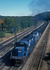 Conrail SD40-2 6387 and 6389 begin to wind up at the rear of a long coal train heading toward Horseshoe Curve, seen passing State Route 53 near Cresson on 2 October 1994
