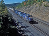 Conrail GP40-2 3287, B37-7 5071 and SD40-2 6439 head down into Altoona with a train of trailers on 2 October 1994