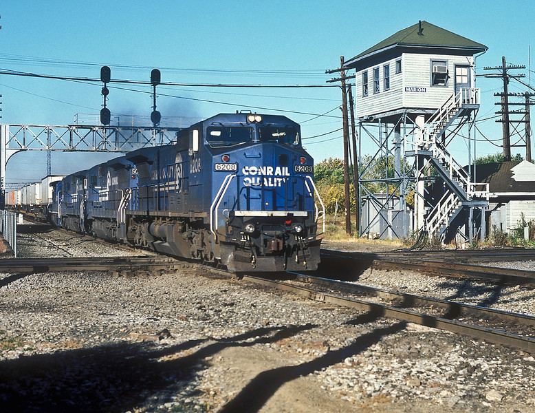 Conrail C40-8W 6208 and B40-8 5073, 5079 and 5072 rush through Marion with a fast eastbound intermodal service on 11 October 1994