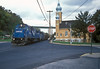 Conrail SD50 6776 and SD40-2 6965 claim right of way across the crossroads at West Brownsville on 4 October 1994 as they head of to the mines with another load of empties