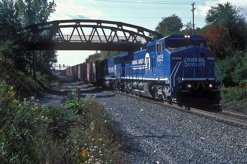 Conrail C40-8W 6235 and 5531 drop down the 'slide' at Gallitzin with an eastbound freight on 30 September 1994