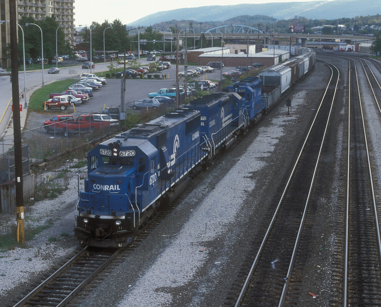 Conrail SD50 6720, SD40-2 6970 and SD40 6317 roll through Altoona with a westbound on 30 September 1994