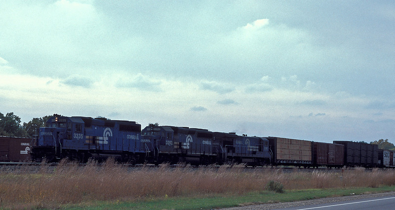 Conrail GP40-2 3335 and 3392 plus GE B40-8 5090 power an eastbound through Elkhart on 14 October 1994