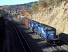Conrail helper set consisting of SD40-2 6359 and 6370 push at the rear of a freight leaving Altoona on 17 October 1994