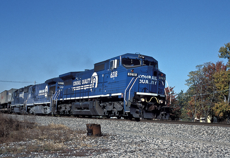 Conrail C40-8W 6218, B36-7 5011 and GP40-2 3341 pass Oak Harbor on 16 October 1994