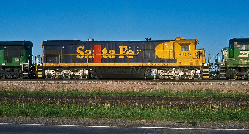 Santa Fe C30-7 8109 is in the consist of a coal train at Alliance, Nebraska on 12 July 1998 - it seems to have got a replacement engine room door from a 'Kodachrome' sister