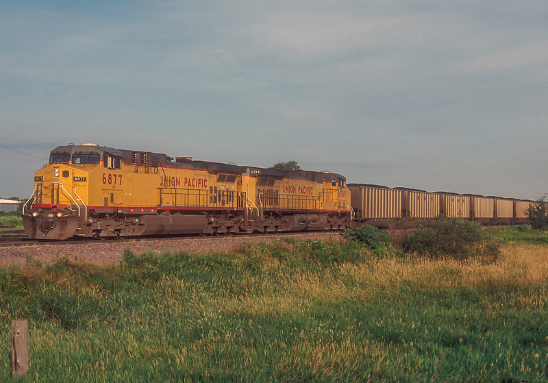 The Union Pacific main line across Nebraska and Iowa is all about moving large amounts of Powder River coal to the east and South with almost half of the trains being huge 100 wagon plus coal trains. At 7 in the morning Union Pacific AC4400CW 6877 and C44-9ACW 6789 arrive at Boone to be re-crewed for their journey eastward.