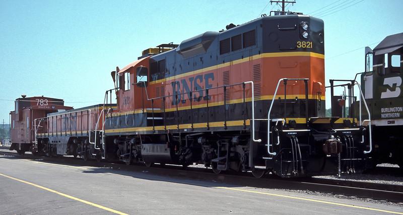 BNSF 3821 and 'slug' 3966 are at Argentine Yard on 20 July 1998