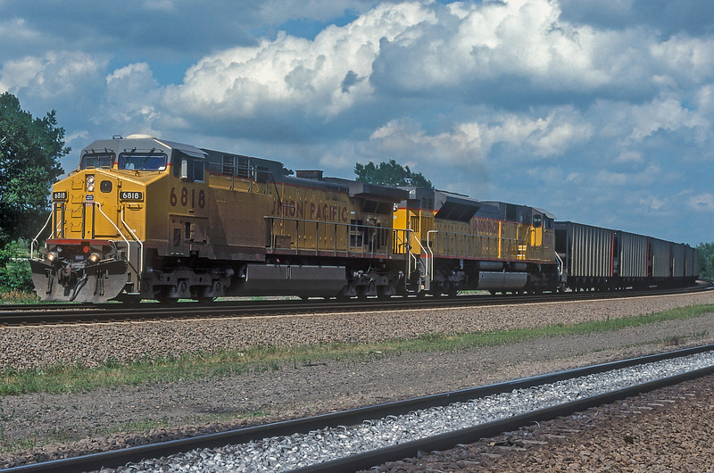 Union Pacific C44-9ACW 6818 and SD9043MAC 8240 are heading back to Bailey Yard with a train of coal empties at North Platte on 11 July 1998.
